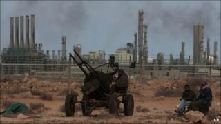 Libyan rebels in front the refinery oil complex in Ras Lanuf, Libya, on 11 March, 2011