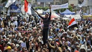 Anti-government protesters chant slogans in Sanaa