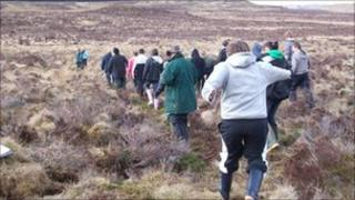 School pupils out on the peat moorland