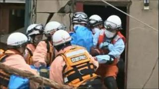 Rescue team brings out a body