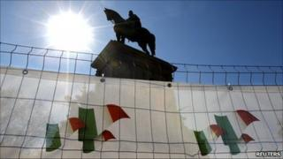 A statue of Italian unification hero Giuseppe Garibaldi with posters marking the 150th anniversary of Italian unification