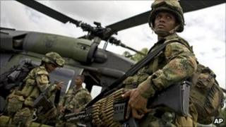 Colombian soldier boarding a helicopter, 9 March 2011