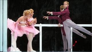 Gennady Yanin dancing in Cinderella at the Bolshoi Ballet in London with the Ugly Sisters (Anastasia Vinokur and Lola Kochetkova)
