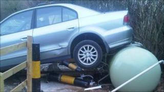 Car on gas tank