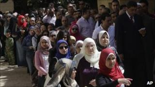 Egyptians queue outside a polling station in Cairo, 19 March