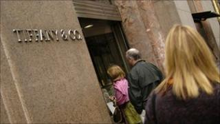 People walk into Tiffany and Co. on Fifth Avenue and 57th Street, Manhattan, New York.