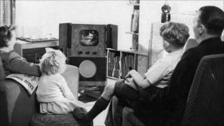 Family watching TV in the 1950s