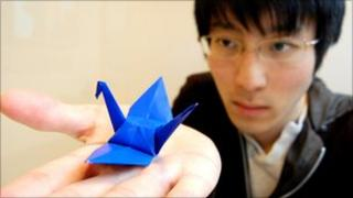 Yoshihiro Kawamura with a paper crane