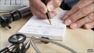 GP writing a prescription