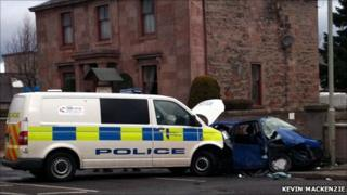 Police van and crashed car