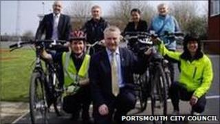 Councillors standing by bikes, launching their bid for the Portsmouth cycling scheme
