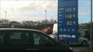 petrol station, displaying prices