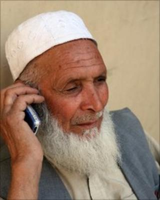 Afghan man uses a mobile telephone