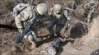 Soldiers from 1st Battalion, Irish Guards during an operation in Afghanistan, March 2011.