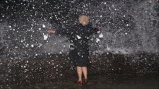 Waves crashing over sea wall at Tywyn, Gwynedd (Pic: Simon Robinson)