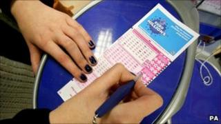 Woman filling in EuroMillions form