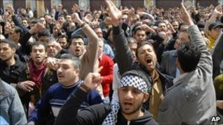 Anti-government demonstrators chant slogans in Damascus, Syria - 25 March 2011