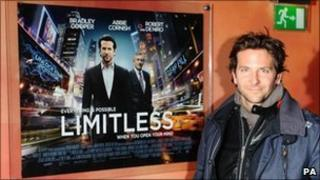 Bradley Cooper beside the Limitless poster