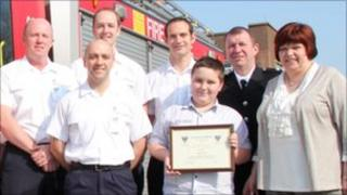 Jake Goode with his parents, joined by firefighters from Coulby Newham Fire Station