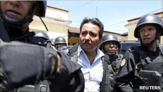 Drug suspect Juan Ortiz Lopez is escorted by police in Guatemala - file photo