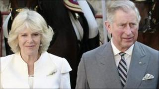 Prince Charles walks next to his wife Camilla at a ceremony at Madrid's town hall on March 31, 2011