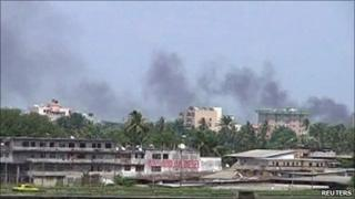 Smoke rises from the city centre of Abidjan - 31 March 2011