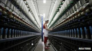 An employee works at the workshop of a textile factory in China