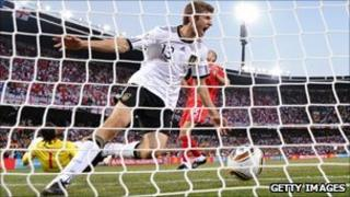 Thomas Mueller celebrates scoring for Germany against England in the 2010 World Cup