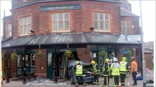 A woman inside the pub was also injured in the crash