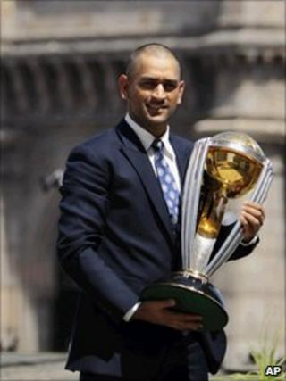 Indian captain Mahendra Singh Dhoni poses with the trophy in Mumbai on April 3, 2011