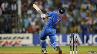 Indian captain MS Dhoni hits the winning shot in the World Cup match