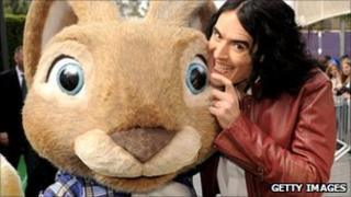 Russell Brand and companion at the Hop premiere in Los Angeles