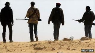 Men holding guns in Libya