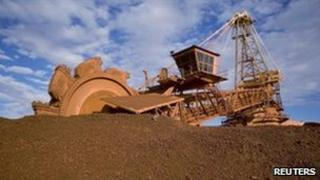 A loader prepares to shovel iron ore dug from an Australian mine