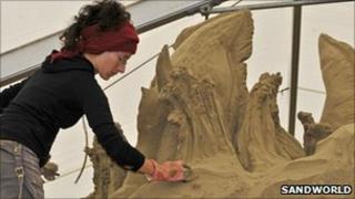 A sand sculptor at work. Copyright of Sandworld.