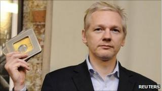 Julian Assange with leaked data, Reuters