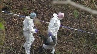 Forensic officers at the scene where the human remains were found