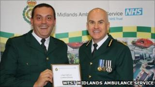 Mr Wheaton (left) being given an award by Anthony Marsh, chief executive of West Midlands Ambulance Service
