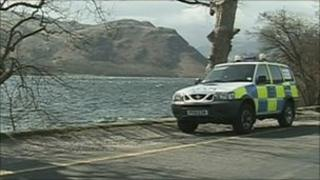 Police car by side of Ullswater