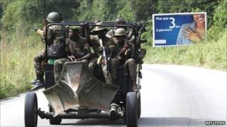 Soldiers loyal to Ivory Coast presidential claimant Alassane Ouattara ride in a vehicle in the main city Abidjan, 6 April 2011