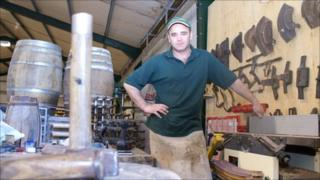 Brewery cooper Pete Coates at his workshop in St Asaph, Denbighshire.
