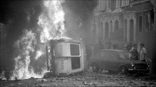 Burning police van