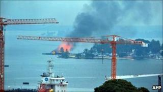 A pro-Gbagbo naval base in Abidjan burns after UN and French air strikes, 10 April