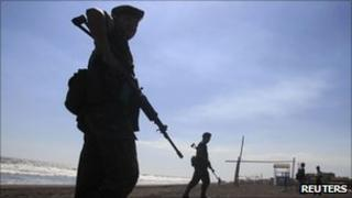 Soldier patrols beach in Guatemala