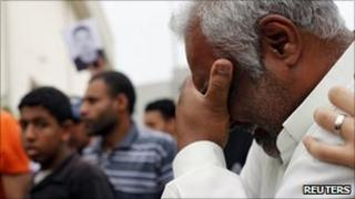 A relative of Ali Issa Saqer cries during his funeral in Manama, 10 April