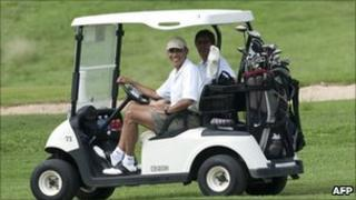 President Barack Obama in a golf cart with friend Mike Ramos in December