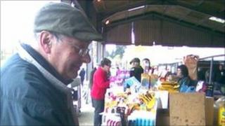 A customer browsing at the last Wednesday Henley Market