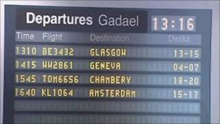 Departure board at Cardiff Airport