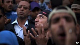 Demonstrators attend a protest in central Tunis on 1 April 2011
