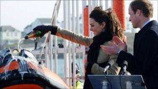 Catherine Middleton and Prince William launch a lifeboat at Treaddur Bay on Anglesey